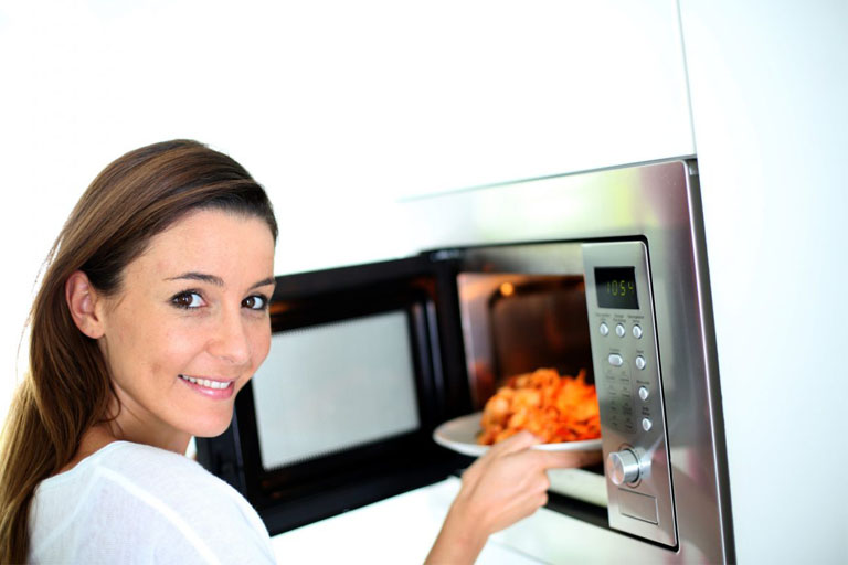woman cooking food with oven