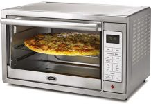 Oster Toaster Oven with pizza inside