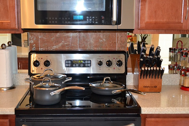 an electric range being used on a kitchen